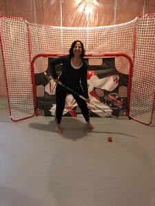 Dr. Dolly Bharwani playing hockey